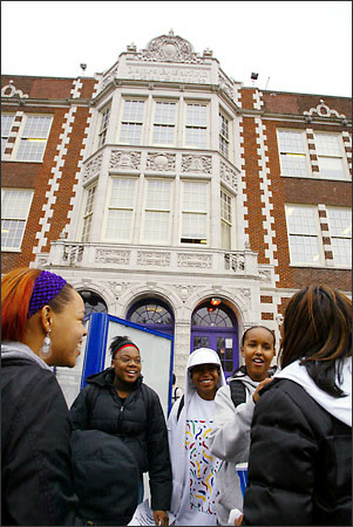 Garfield High students Brenia Sherrod, 16, Takiyah Ward, 16, and Nasra Abdule, 16, stand outside the school during lunchtime. About 30 percent of students at Garfield are black, a dramatic decline from the early '70s. Some parents believe their children are being excluded from honors classes at their