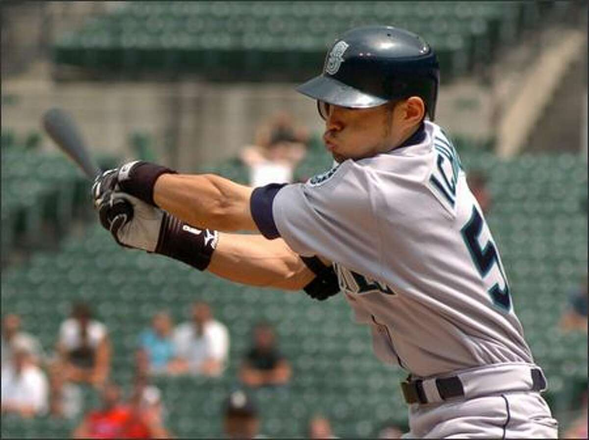 Seattle Mariners' Ichiro Suzuki connects for his second hit of the game off the Orioles' Sidney Ponson in the third innning. Ichiro went 5-5, but the Mariners lost the first game of a double header to the Orioles 9-7. (AP Photo/Gail Burton)