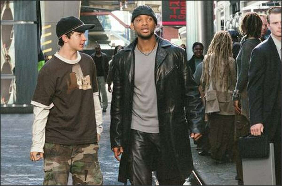 Will Smith, as Det. Del Spooner, offers some advice to a street kid played by Shia LaBoeuf. Smith stars as a robot-phobic police detective investigating a murder where the circumstances seem to violate the Three Laws of Robotics.