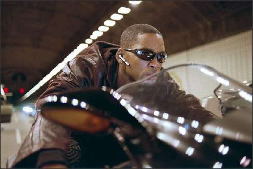 Det. Del Spooner (Will Smith) races to the scene of an incredible robot uprising. His aversion to technology -- and to robots, in a world where they're an essential part of everyday life -- was seen as a critical element of the film.