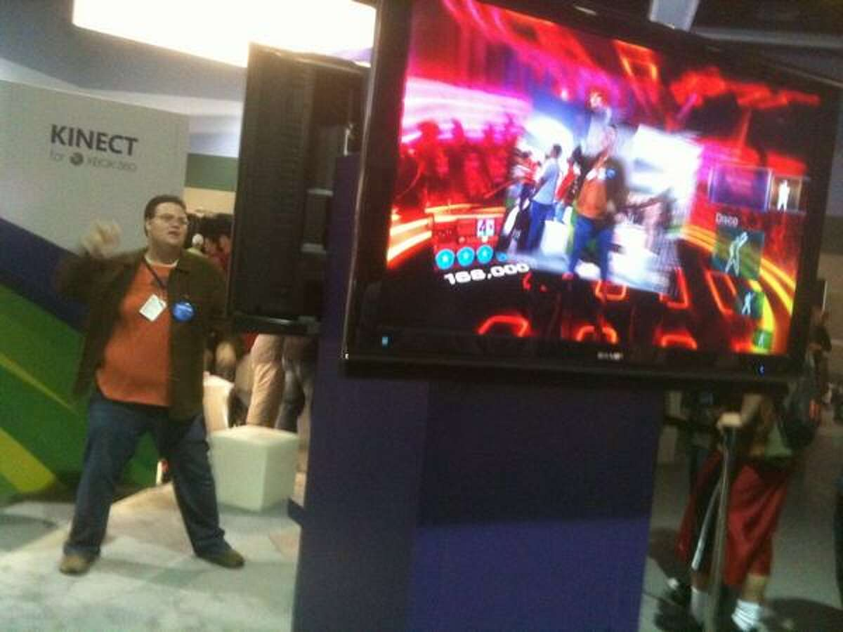 A PAX attendee dances along with a Kinect video game for Microsoft's Xbox 360 console Friday.l