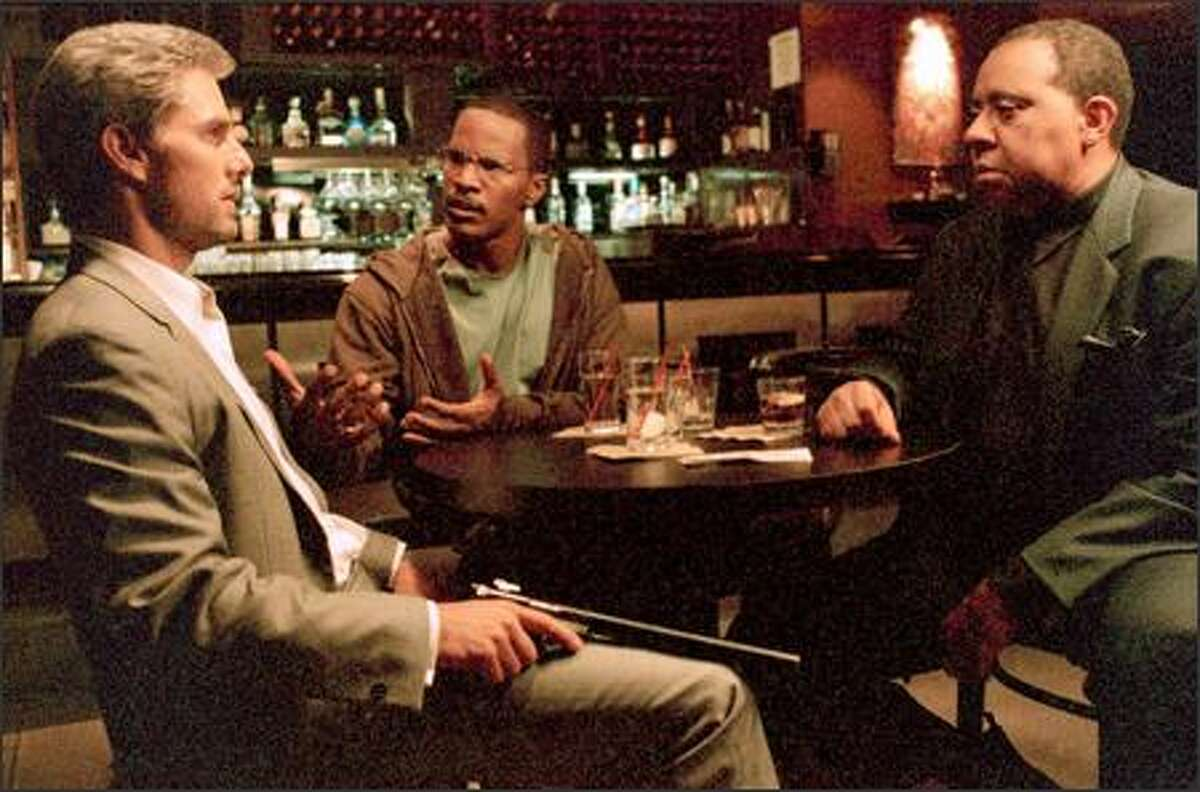 Max (Jamie Foxx, center) tries to intervene with Vincent (Tom Cruise, left) to save the life of Daniel (Barry Shabaka Henley), one of the people Vincent was contracted to kill.