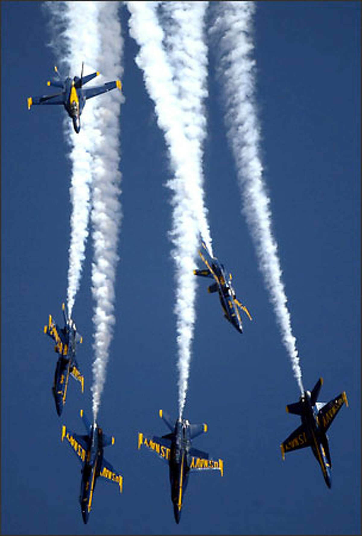 The U.S. Navy's Blue Angels precision aerobatics team heads straight down toward Lake Washington at Seafair.