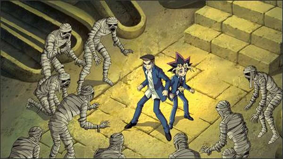Tristan and Yugi are surrounded by Anubis' crew of mummies. While the