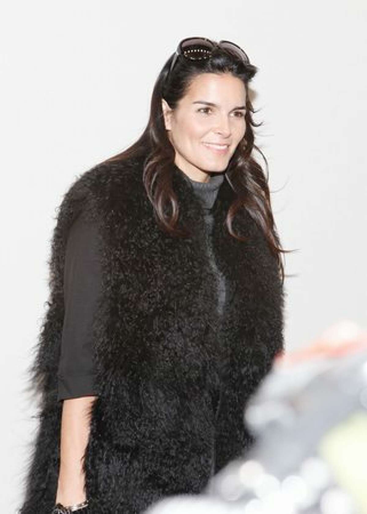 Actress Angie Harmon attends the Michael Kors Fall 2011 show with FIJI Water during Mercedes-Benz Fashion Week at The Theatre at Lincoln Center in New York City.