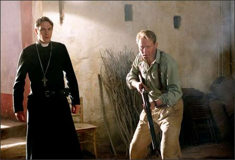 "James D'Arcy and Stellan Skarsgård star in ""Exorcist: The Beginning,"" a prequel to the 1973 film ""The Exorcist."" D'Arcy plays Father Francis and Skarsgård plays Father Lankester Merrin as a younger version of the role Max von Sydow played in the earlier film. Photo: Warner Brothers"