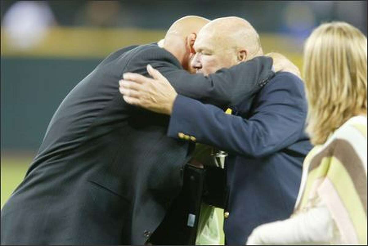 Jay Buhner hugs his dad Dave after the ceremony.