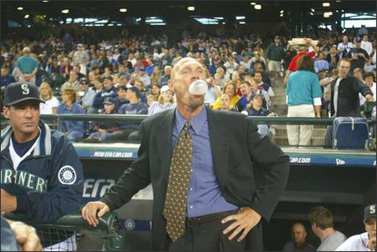 Jay Buhner blows a bubble as he waits to be introduced.