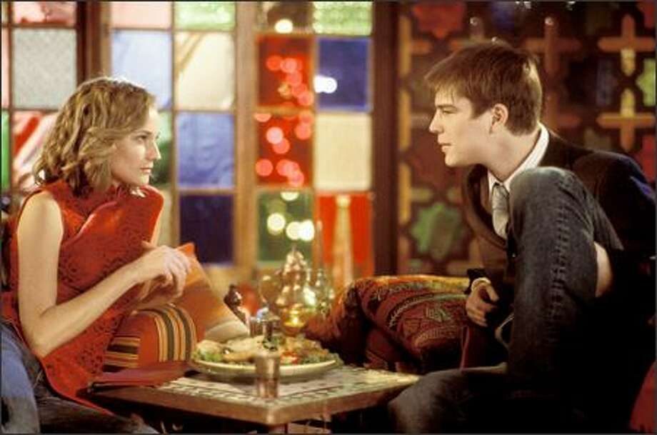 "Lisa (Diane Kruger) and Matthew (Josh Hartnett) have dinner in the psychological drama ""Wicker Park."" The film is rated PG-13 for sexuality and language. Photo: MGM"
