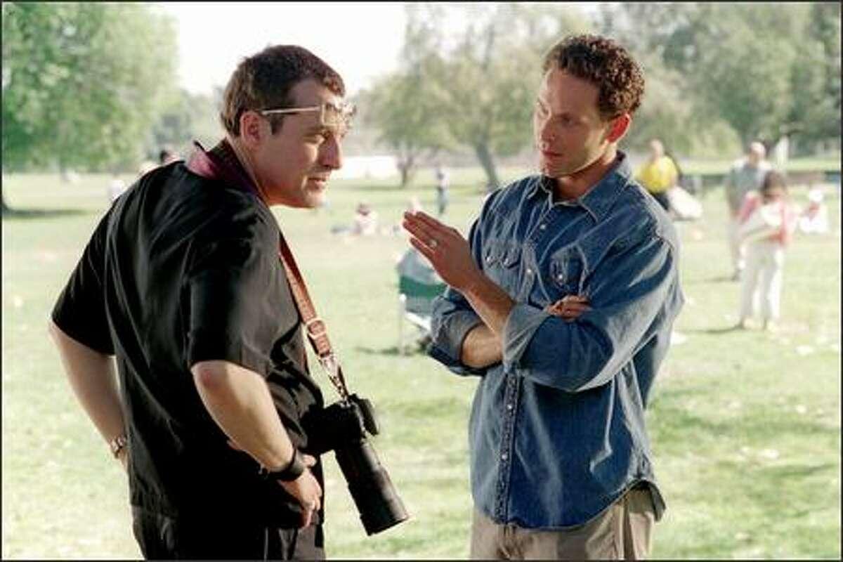Movie star Bo Laramie (Cole Hauser) confronts relentless paparazzo Rex Harper (Tom Sizemore).