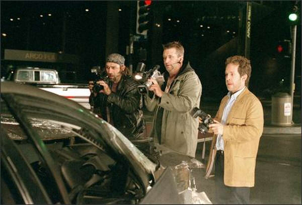 Paparazzi (from left) Kevin Rosner (Kevin Gage), Wendell Stokes (Daniel Baldwin) and Leonard Clark (Tom Hollander) create a photo opportunity out of a tragic accident.