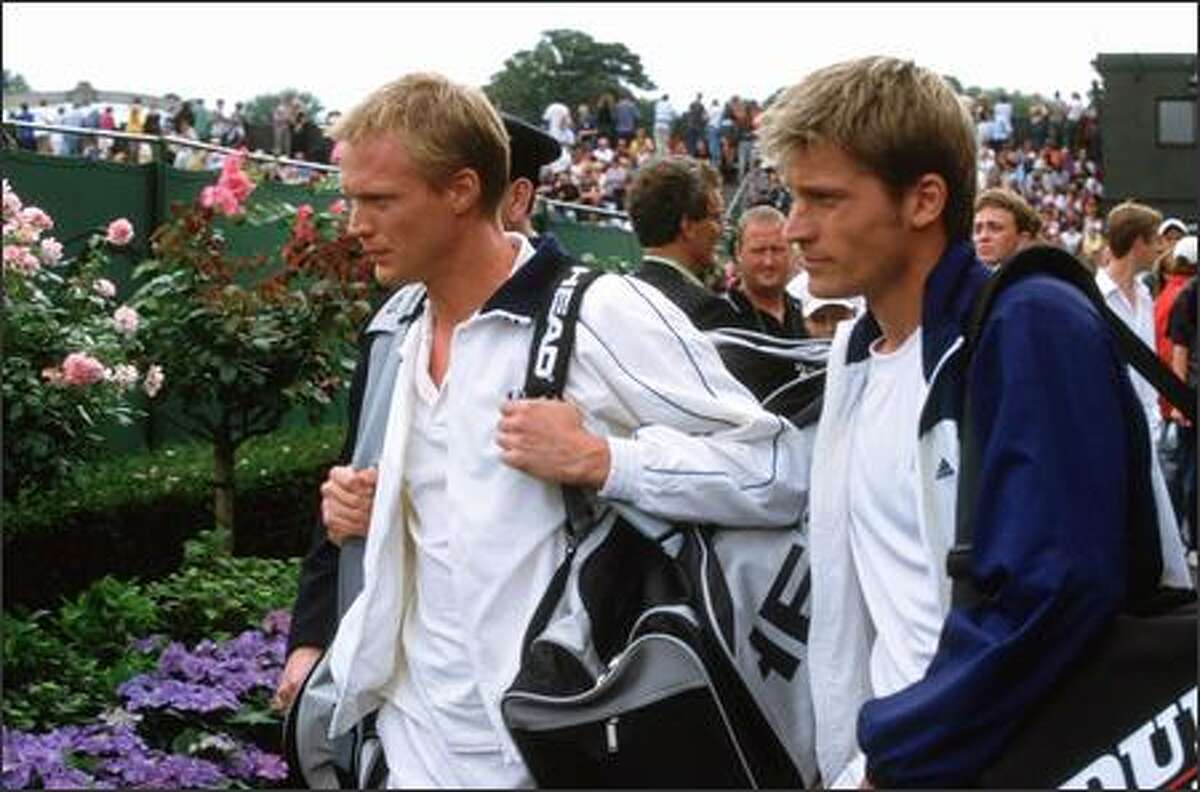 Peter Colt (Bettany) and practice partner Dieter Proll (Nikolaj Coster-Waldau) take in the Wimbledon crowds.