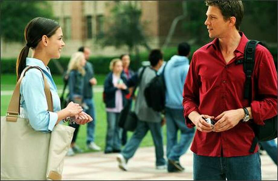 Samantha (Katie Holmes) meets James (Marc Blucas), her dormitory Resident Advisor. They soon find themselves falling for each other. Photo: Twentieth Century Fox