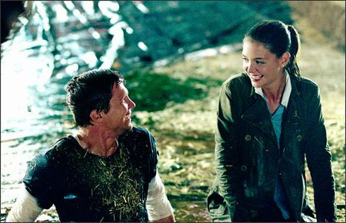 When Samantha (Katie Holmes) first falls for James (Marc Blucas), it's not all blaring trumpets; it is a much more down-to-earth romance.