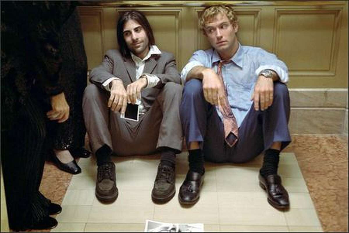 The existential investigators are convinced that the key to client Albert Markovski's (Jason Schwartzman, left) existence lies in his conflict with apparent polar opposite Brad Stand (Jude Law), a golden boy executive climbing the corporate ladder at super-store chainHuckabees.