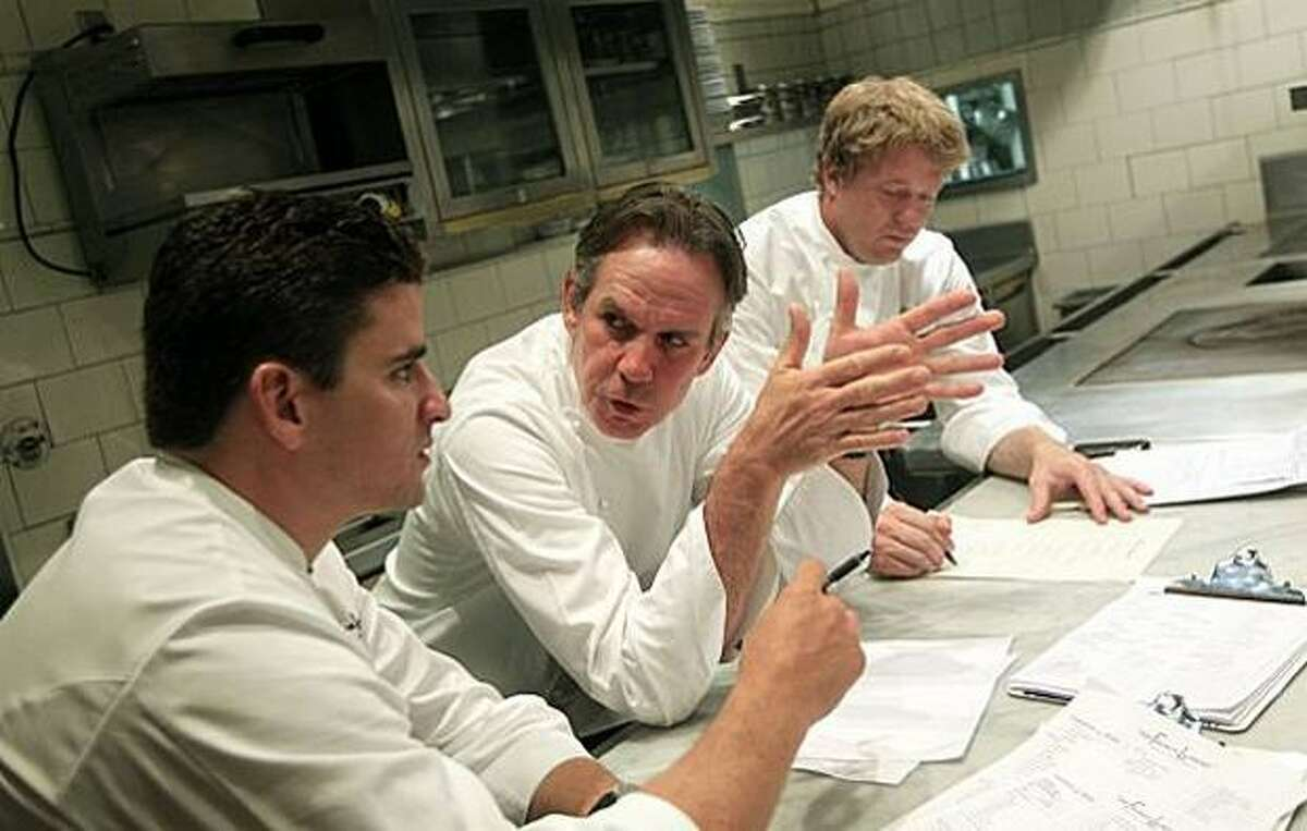French Laundry executive chef Thomas Keller, center, confers with his chef de cuisine, Timothy Hollingsworth, right, and sous chef Anthony Secviar, left, as the team of chefs changes the menu.
