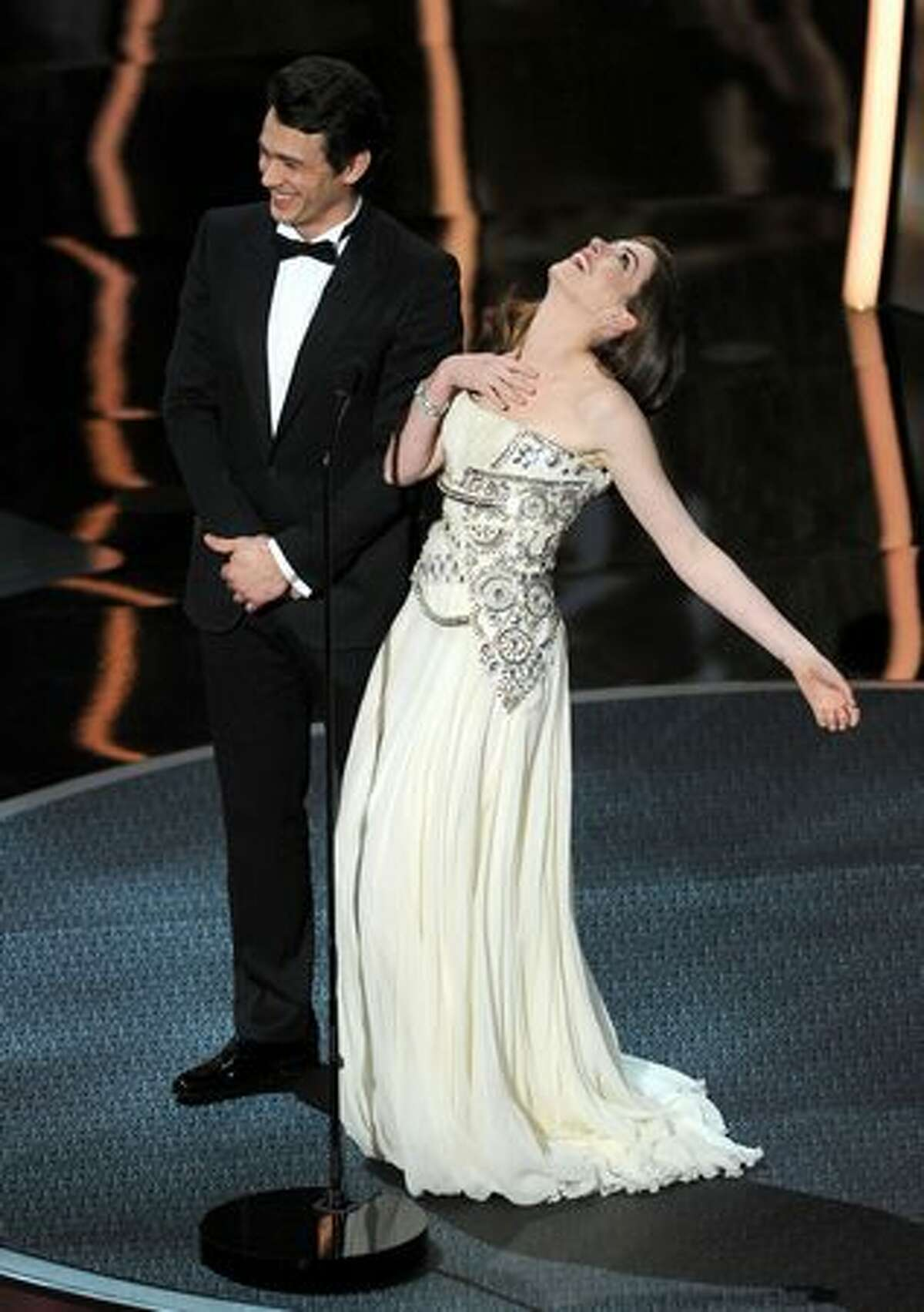 Hosts James Franco and Anne Hathaway speak onstage during the 83rd Annual Academy Awards held at the Kodak Theatre in Hollywood, California.