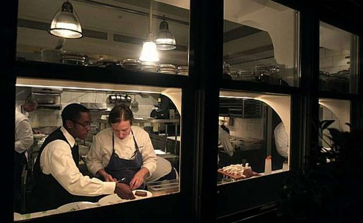 Food runner Chris Gaither and chef de partie Adina Guest team up to plate one of 13 courses served at the French Laundry.