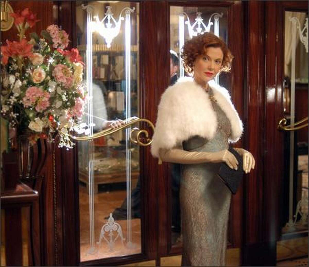 Symbolism also plays a major part in the look of the film. Julia (Annette Bening) is always surrounded by mirrors because she is constantly aware of her looks, always checking to see if she is still beautiful, still sexy.