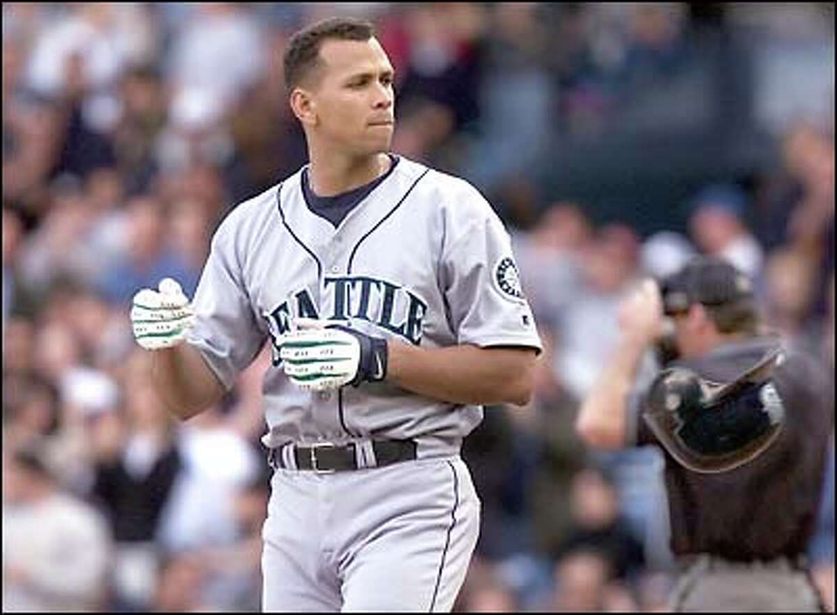 Alex Rodriguez tosses his batting helmet aside after popping out to Scott Brosius to end the third inning.