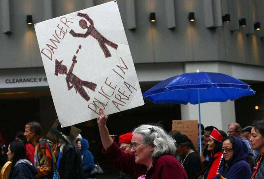 Marchers protest the recent police shooting of Native American carver John T. Williams during a march to City Hall. Williams was shot and killed by a Seattle Police officer while he was holding a knife and did not put it down when ordered. Williams used the knife to carve small totems and was deaf in one ear. Photo: Joshua Trujillo, Seattlepi.com