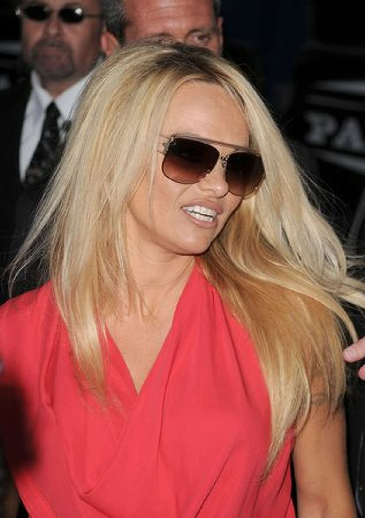 Actress Pamela Anderson arrives at PETA's 30th Anniversary Gala and Humanitarian Awards at The Hollywood Palladium in Los Angeles on Saturday, Sept. 25, 2010.