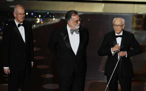(L-R) Film historian and preservationist Kevin Brownlow, producer/director Francis Ford Coppola and actor Eli Wallach are given the Governors Awards during the 83rd Annual Academy Awards held at the Kodak Theatre in Hollywood, California. Photo: Getty Images