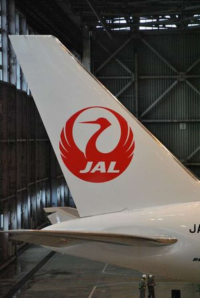 Japan Airlines unveils a new Boeing 767-300ER painted with the airline's latest crane livery at Tokyo's Haneda Airport. (Japan Airlines) See the original post
