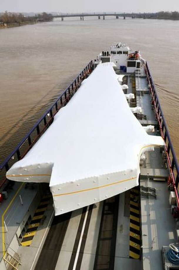 A barge carrying an Airbus A380 wing sails on the Garonne river in Bordeaux. The wings, assembled in Broughton, U.K., are transported by road and river craft to Mostyn harbour, loaded onto a custom-built roll-on, roll-off ferry for the trip to Pauillac harbour, France, barged to Langon and then sent by road to the Toulouse Airbus assembly line. Photo: Getty Images