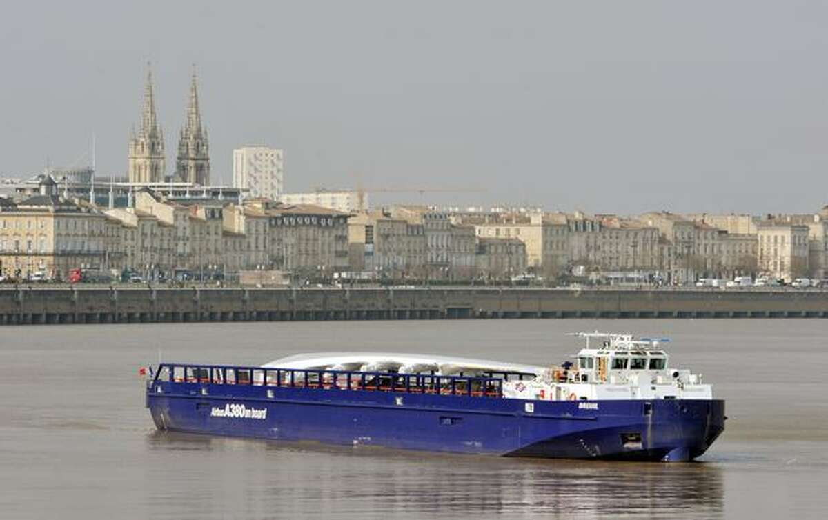 A barge carrying an Airbus A380 wing sails on the Garonne river in Bordeaux. The wings, assembled in Broughton, U.K., are transported by road and river craft to Mostyn harbour, loaded onto a custom-built roll-on, roll-off ferry for the trip to Pauillac harbour, France, barged to Langon and then sent by road to the Toulouse Airbus assembly line.