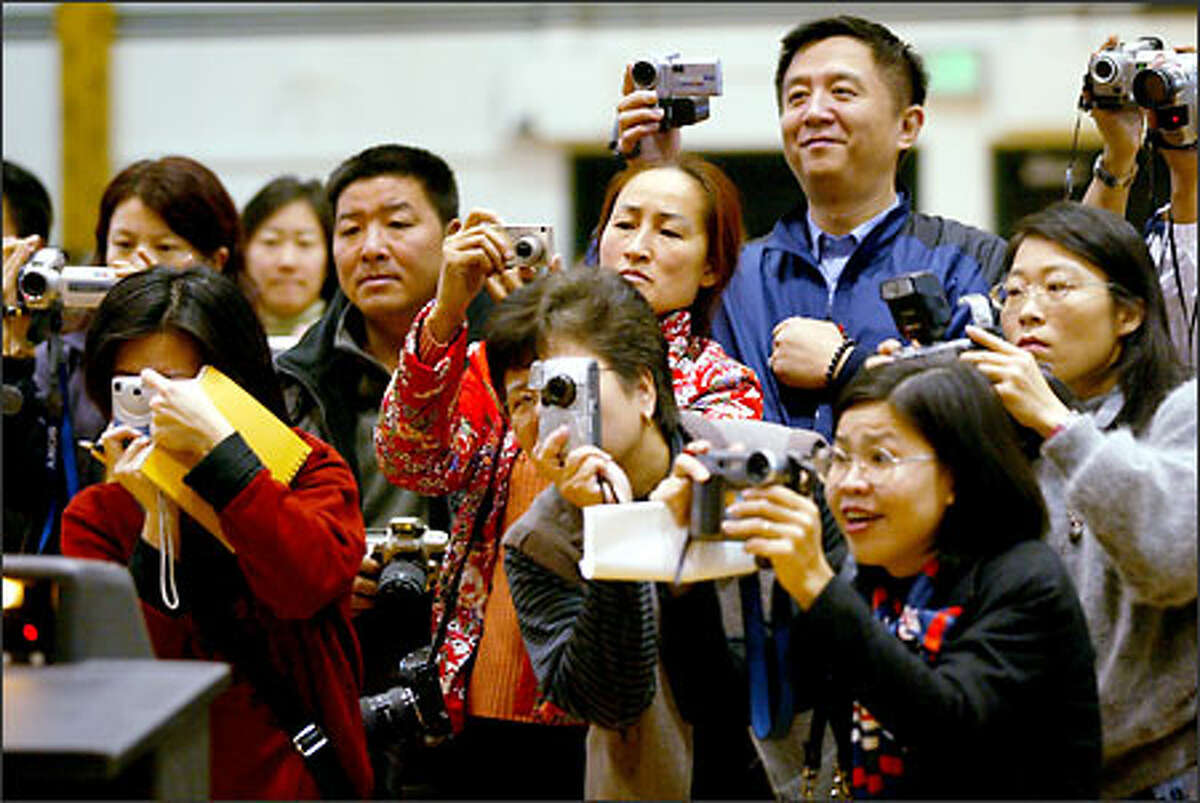 Fans capture the moment at the opening ceremony of the 19th World Basketball Invitational Tournament for Chinese at Franklin High School yesterday.Webber: