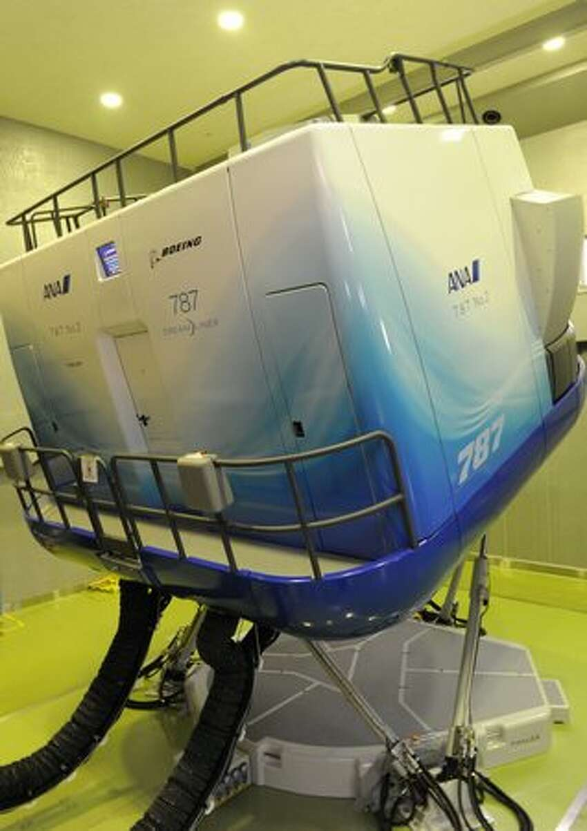 An All Nippon Airways flight simulator for Boeing's 787 Deamliner is displayed at ANA's training center near Tokyo's Haneda airport.