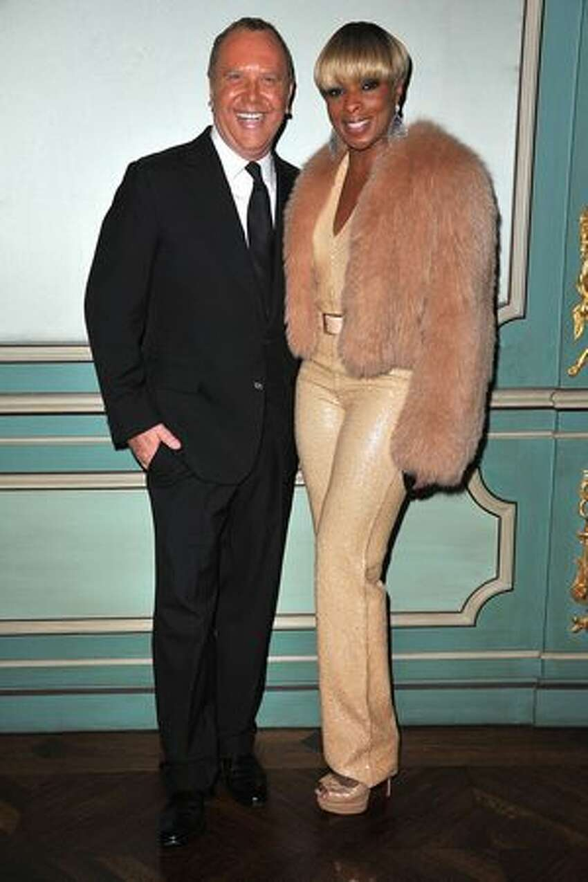 Michael Kors and Mary J. Blige attend a cocktail and dinner hosted in honor of designer Michael Kors during Paris Fashion Week Fall/Winter 2012 at the Embassy Of The United States in Paris, France.