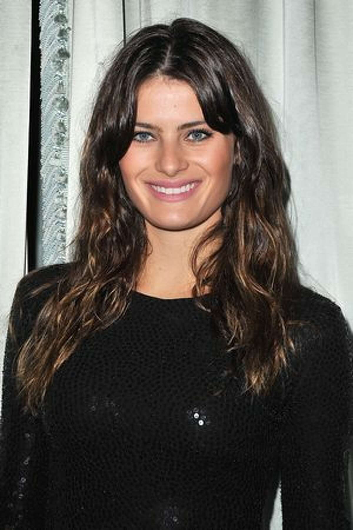 Isabeli Fontana attends a cocktail and dinner hosted in honor of designer Michael Kors during Paris Fashion Week Fall/Winter 2012 at the Embassy Of The United States in Paris, France.