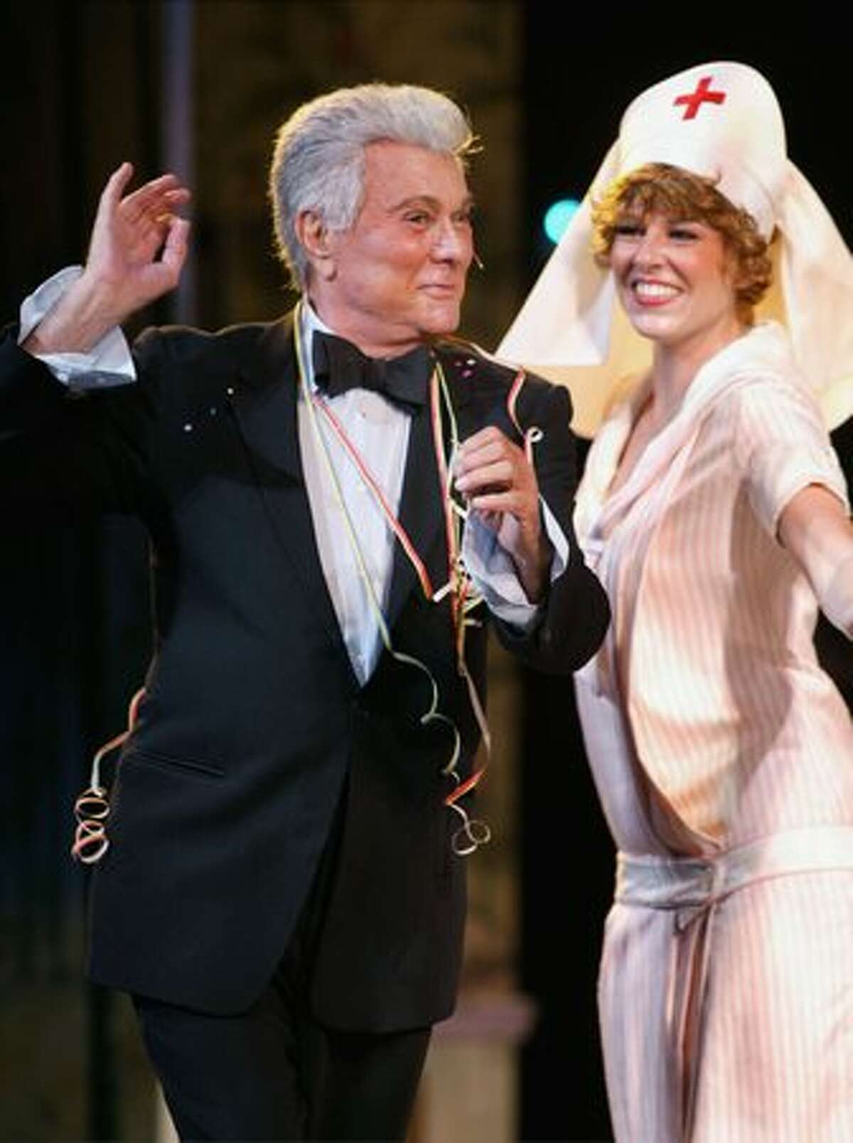 Tony Curtis performs as the multi-millionaire, Osgood Fielding III, in the musical
