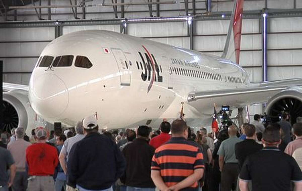 Employees at Boeing's Global Services & Support site in San Antonio, Texas celebrate the arrival of the first 787 Dreamliner to undergo change incorporation work.