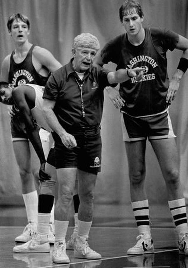 Coach Marv Harshman gives pointers to University of Washington stars Detlef Schrempf, left, and Chris Welp in his final coaching year, Nov. 20, 1984. Photo: P-I File