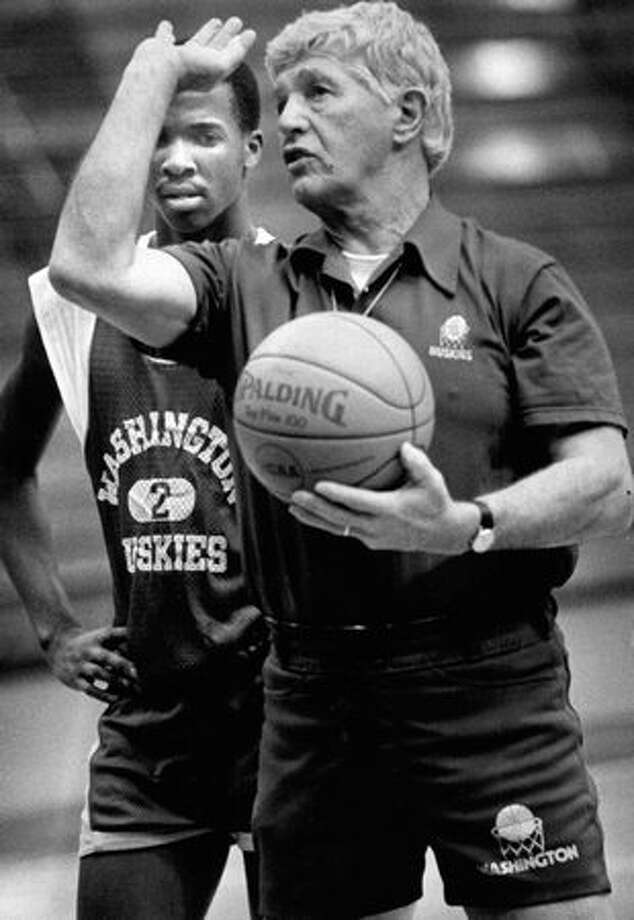 Coach Marv Harsman gives tips on foul shooting to Husky freshman David Wilson during practice, 1984. Photo: P-I File