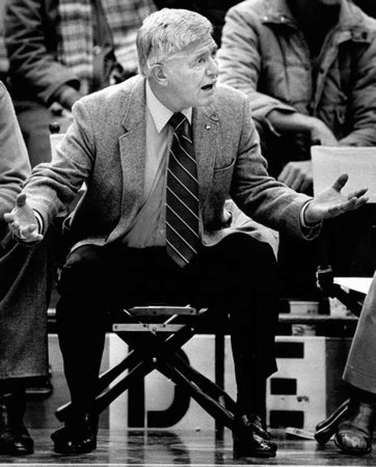 Marv Harshman watches as his Huskies play. Mar. 20, 1984. Photo: P-I File