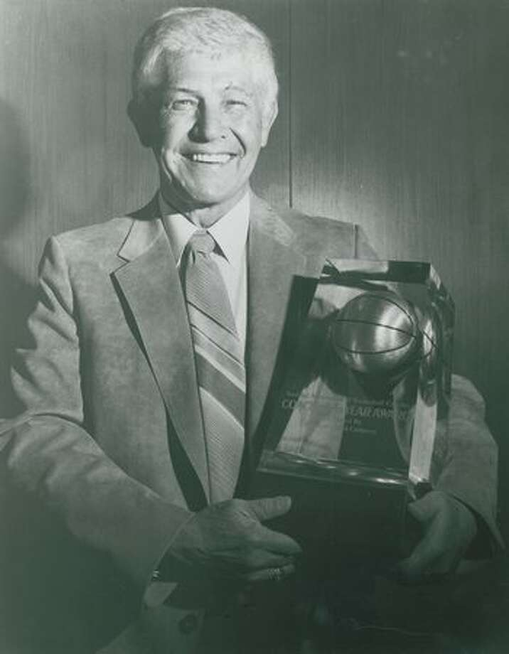 Marv Harshman with his Kodak Division 1 Coach of the Year award, 1985. After four decades of coaching, Harshman ended his career at the UW. Photo: P-I File