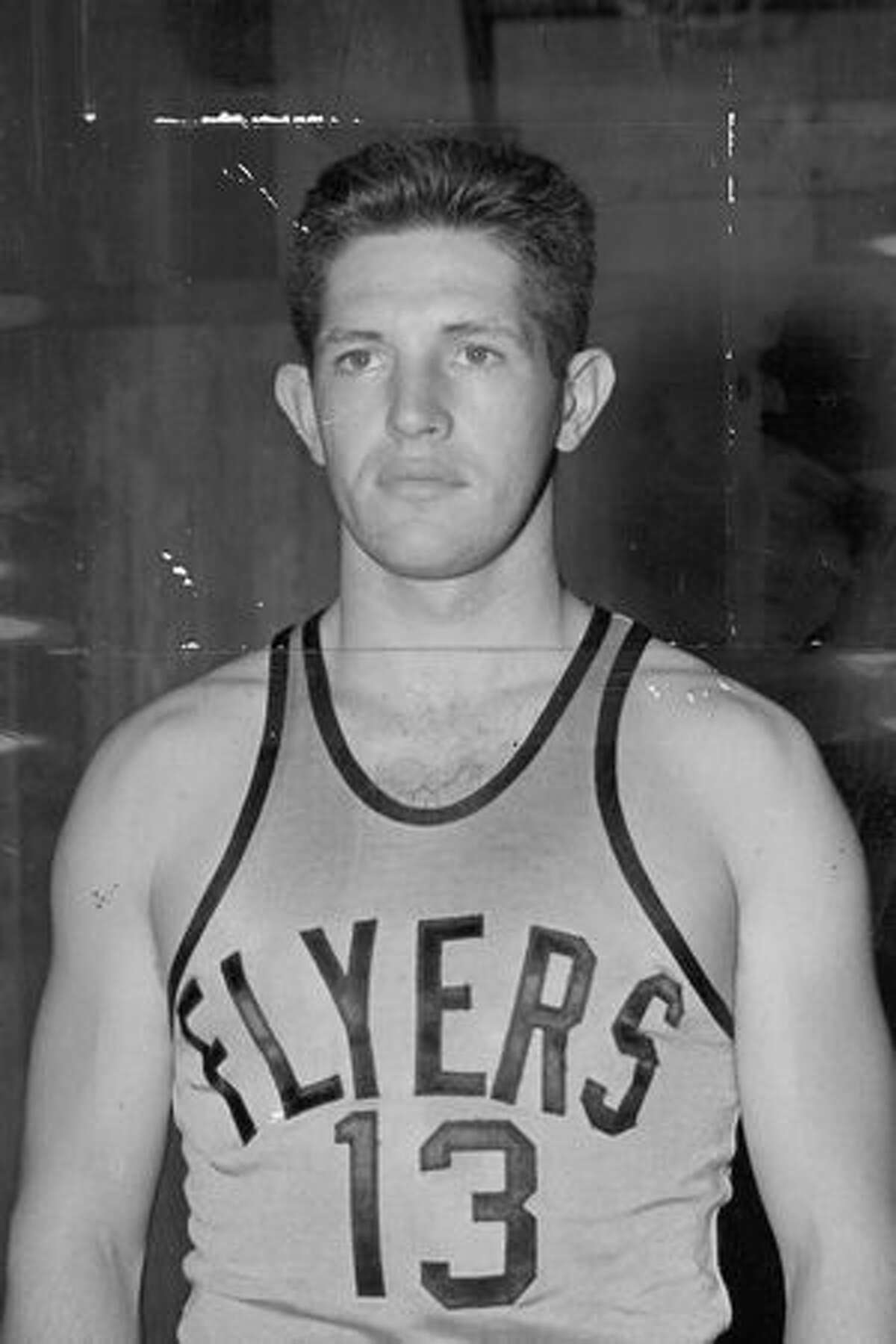Marv Harshman as a basketball player for the Navy team, December 9, 1942.