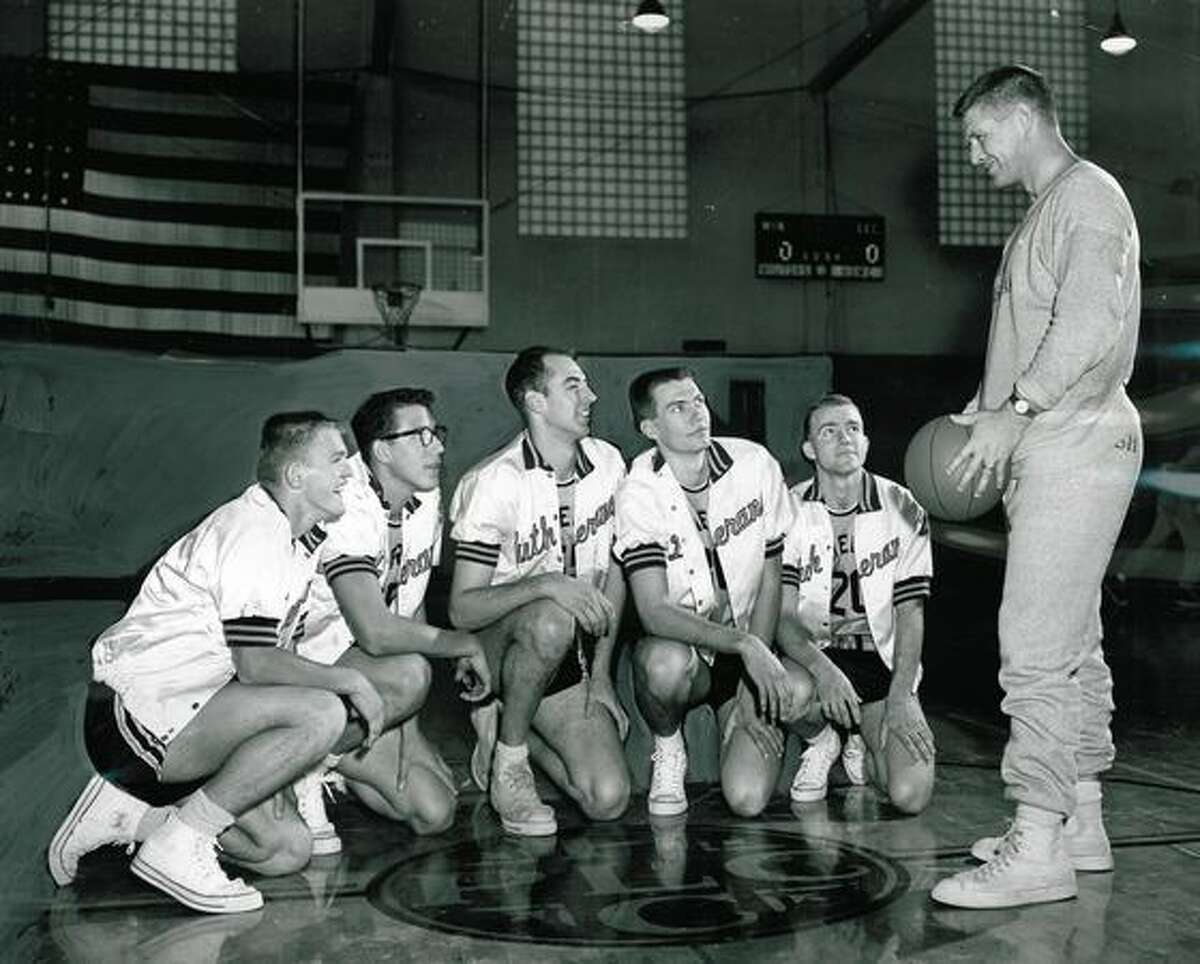 Marv Harshman, right, as coach of the Pacific Lutheran College basketball team, Feb. 26, 1957.