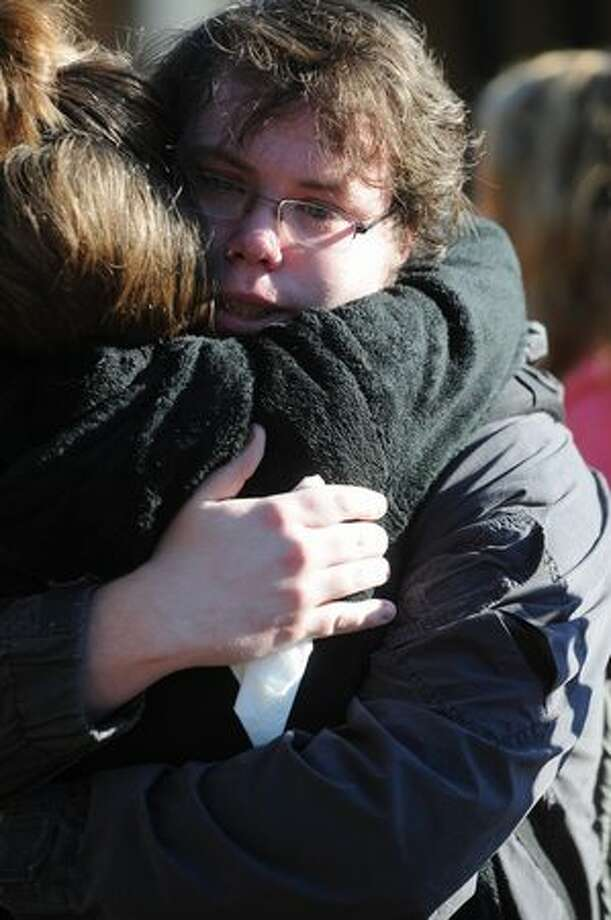 Western junior Wyatt Jarvis hugs friend Ashley Hill during a memorial for Dwight Clark, 18, at Western Washington University in Bellingham. Photo: Daniel Berman, Special To Seattlepi.com