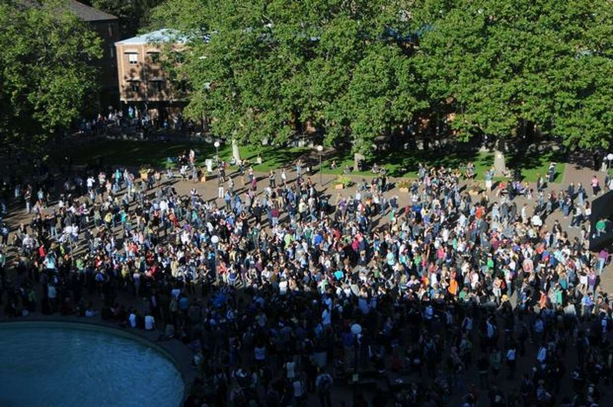 Hundreds of Bellingham residents and Western students gather at a memorial for Dwight Clark, 18, at Western Washington University in Bellingham. Clark's body was identified today after being found in Bellingham Bay by a contractor working on the waterfront near the former Georgia-Pacific plant.