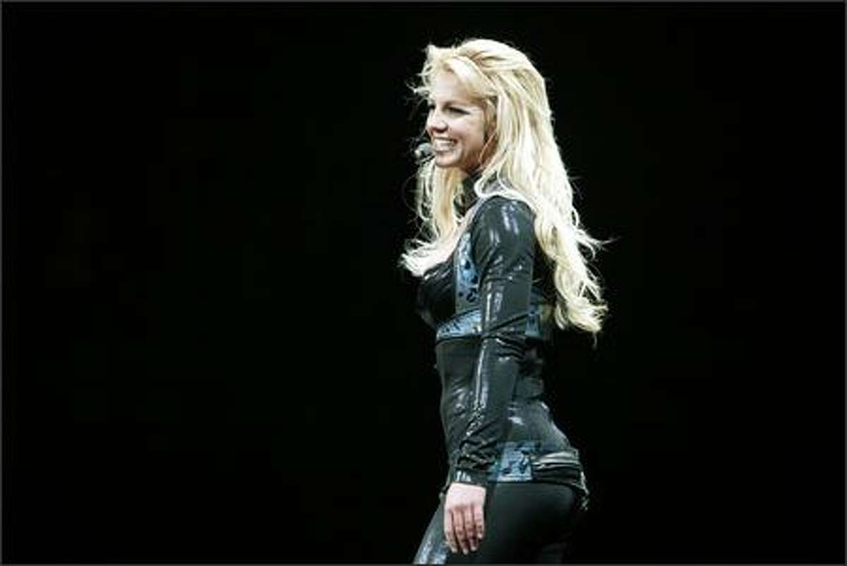 Britney Spears talks to the audience during her Onyx Hotel Tour stop at KeyArena.