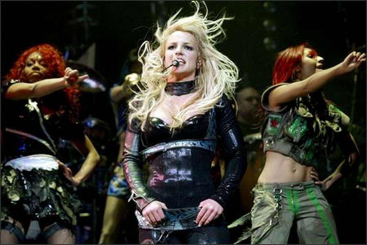 Britney Spears performs with her dancers.