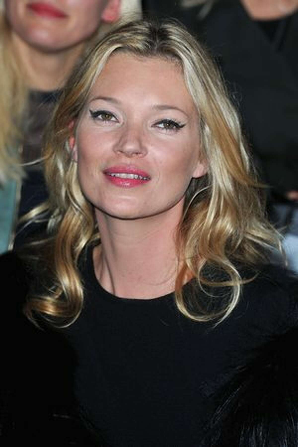 Kate Moss attends the Christian Dior Ready to Wear Spring/Summer 2011 show during Paris Fashion Week in Paris, France.