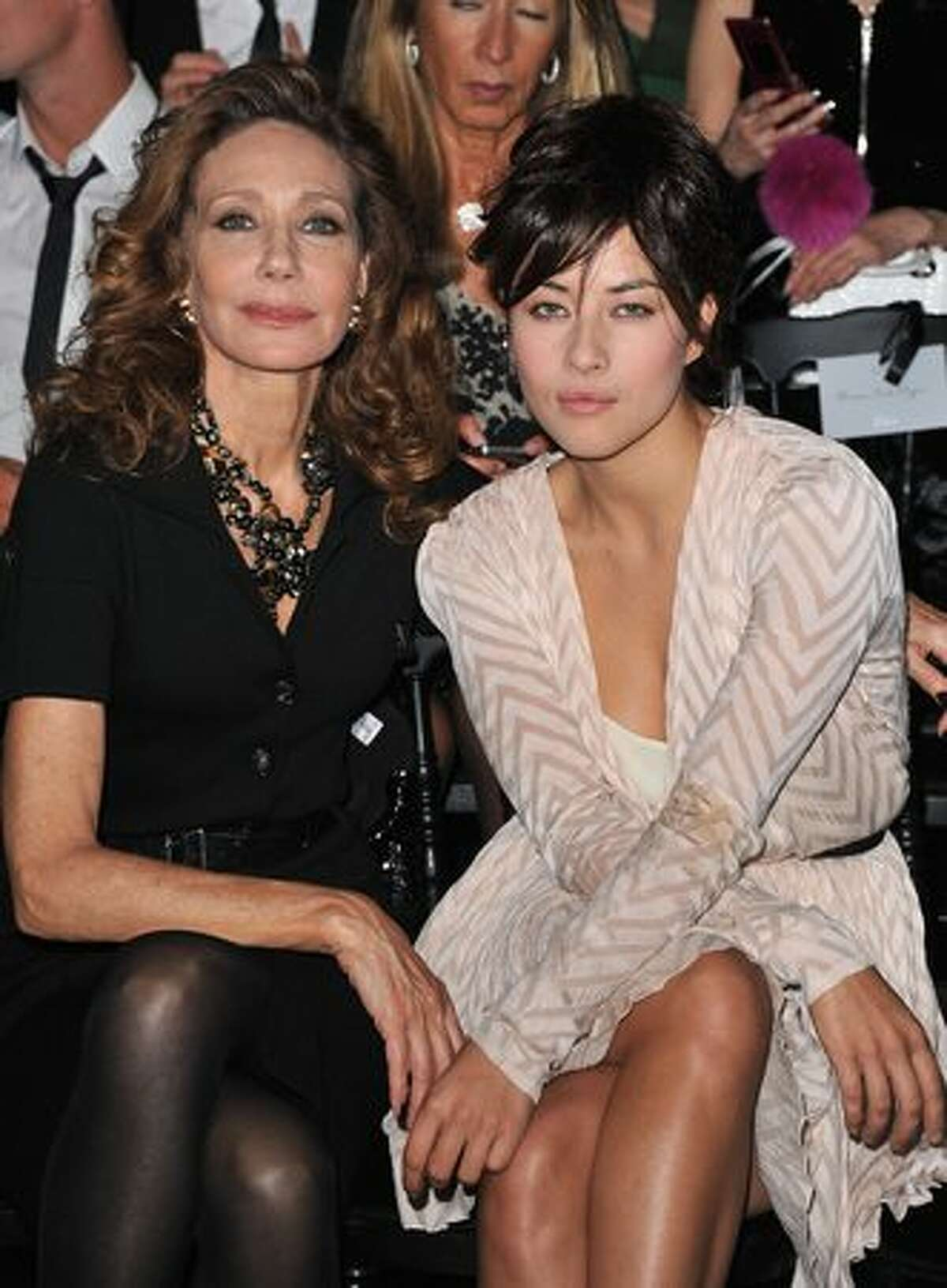 Marisa Berenson and Mylene Jampanoi attend the Christian Dior Ready to Wear Spring/Summer 2011 show during Paris Fashion Week at Espace Ephemere Tuileries in Paris, France.