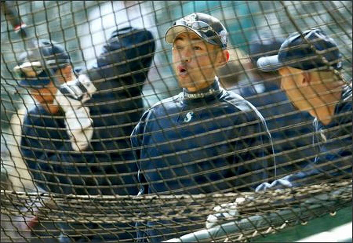Ichiro Suzuki's face lights up after a loud crack of the bat made by one of his teammates during batting practice prior to Opening Day ceremonies at Safeco Field.