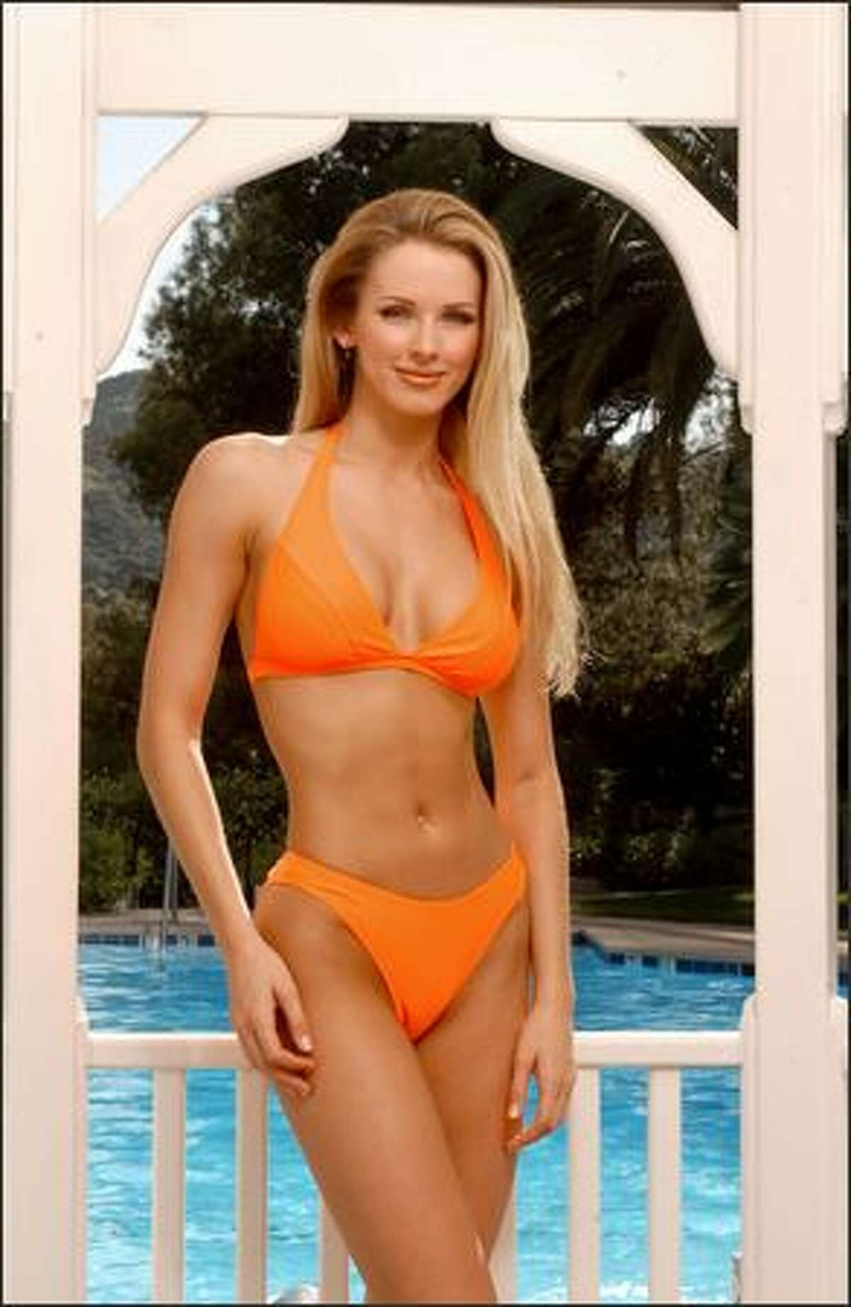 Shandi Finnessey, Miss Missouri USA 2004, poses in her Endless Sun swimsuit during registration and fittings for the Miss USA 2004 competition at the Universal Hilton Hotel in Los Angeles on March 30.